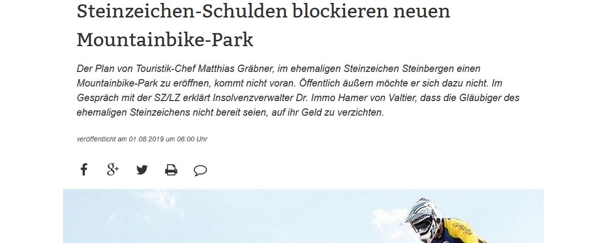 Steinzeichen-Schulden blockieren neuen Mountainbike-Park